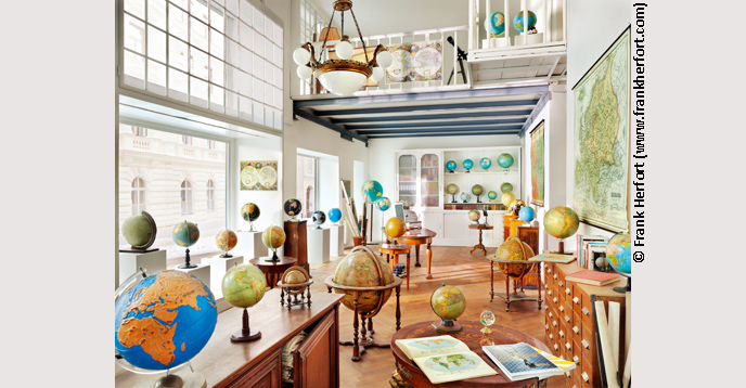 A collection of antique globes at a shop in downtown Vienna, Austria, 2011. Part of German photographer Frank Herfort's Interiors-Public series.